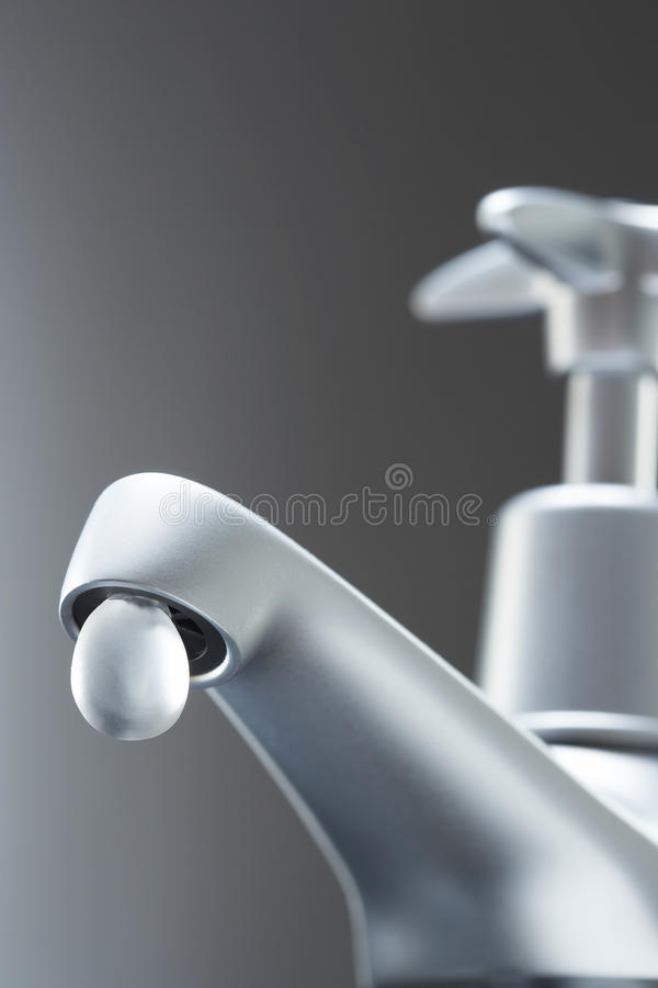 Tap with large drop of water stock photos