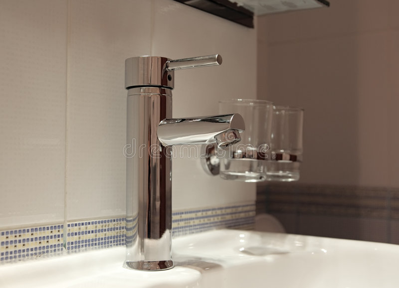 Tap in modern bathroom royalty free stock photography