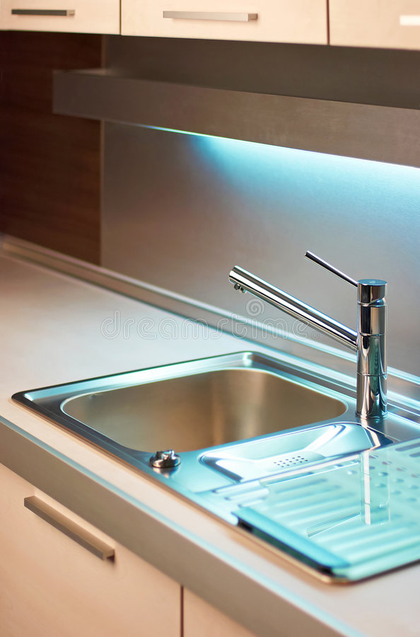 Tap in modern kitchen stock photography