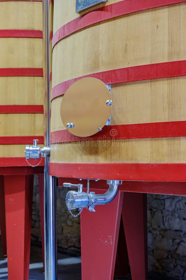 Tap and part of the structure of a large barrel where it starts to ferment grape wine to become royalty free stock photos