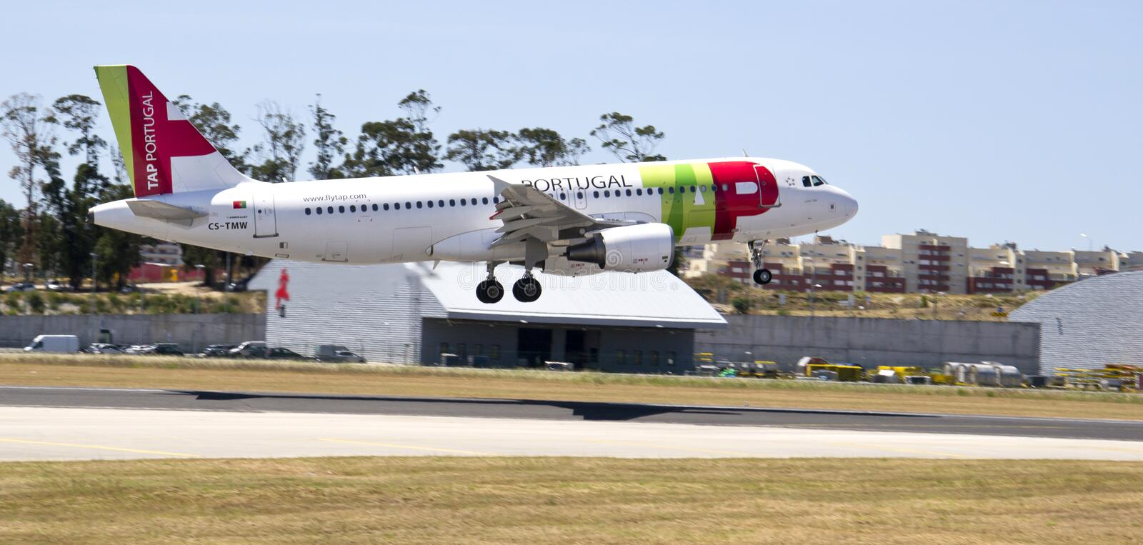 TAP PORTUGAL AIRBUS 320. OPORTO, PORTUGAL - JULY 1: Many flights operated by TAP will be affected for the strike from 5th till 8th july. A TAP aircraft landing stock photos