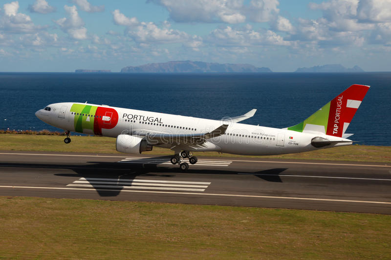 TAP Portugal Airbus A330. Madeira, Portugal - February 26, 2012: A TAP Portugal Airbus A330 with the registration CS-TOE approaches Madeira airport (FNC). TAP royalty free stock photo