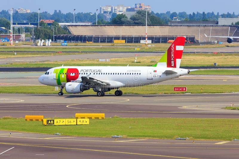 TAP Portugal Airbus A319. Airbus A319 of TAP Portugal Transportes Aéreos Portugueses taxiing at Amsterdam Schiphol Airport stock photography