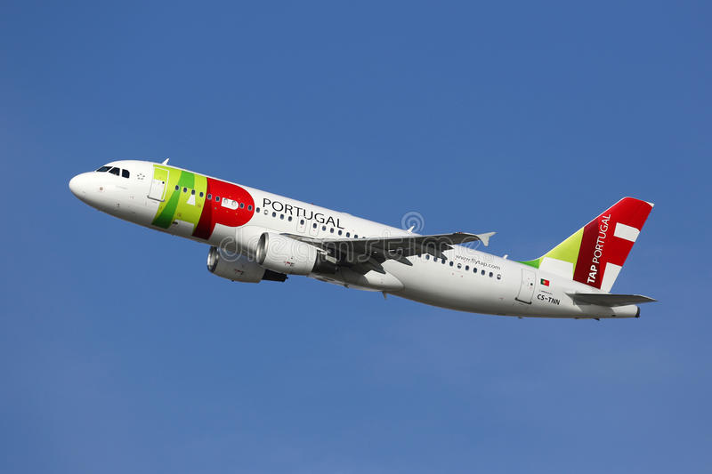 TAP Portugal Airbus A320 airplane. Barcelona, Spain - December 12, 2014: A TAP Portugal Airbus A320 with the registration CS-TNN taking off from Barcelona royalty free stock photos