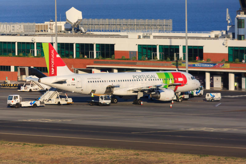 TAP Portugal jet. TAP Portugal (Transportes Aéreos Portugueses) Airbus A320 parked at Funchal airport on Madeira stock photo