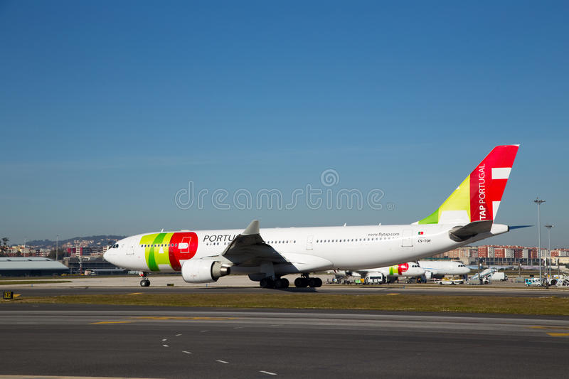 Tap portugal. LISBON, PORTUGAL- January 9th, 2015: A Tap Portugal flight in Lisbon on the 9th of january 2015 Lisbon, Portugal. Tap is the national airline of stock photography