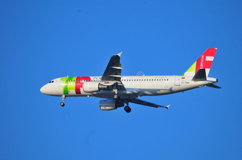 TAP Portugal plane. This is a view of TAP Portugal plane landing over the Fiumicino Airport. October 6, 2014. Rome Airport in Fiumicino, Italy stock images