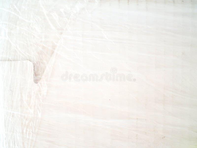 Tapa blanca de la caja de cartón, cubierta con el envoltorio de plástico fotografía de archivo libre de regalías