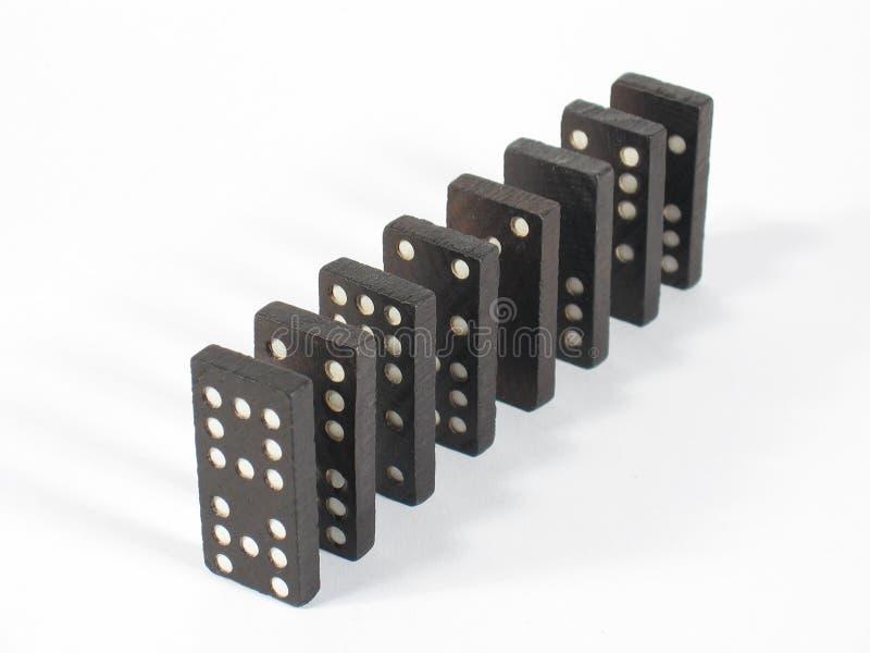 Tapa de la fila del dominó imagenes de archivo