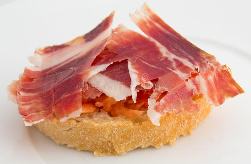 Tapa, jamón y tomate españoles fotos de archivo