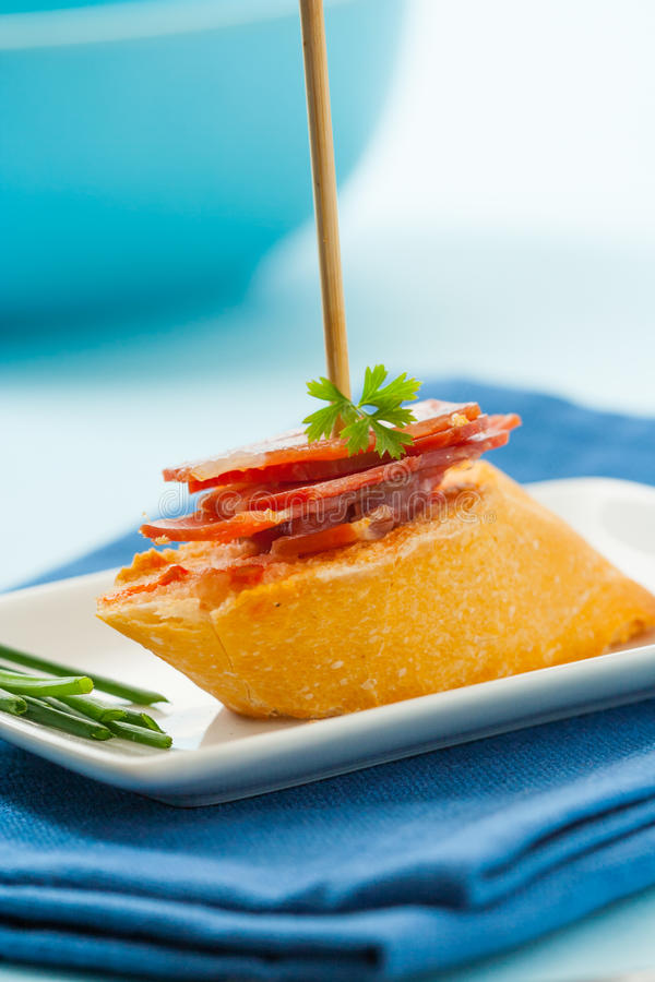 Tapa with serrano ham. Spanish montadito tapa with serrano ham stock images