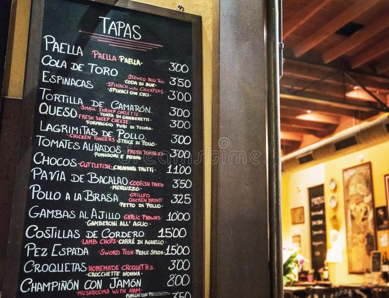 Tapas bar in Spain. Spanish tapas bar in historical center of Seville at night. Food and travel concept stock image