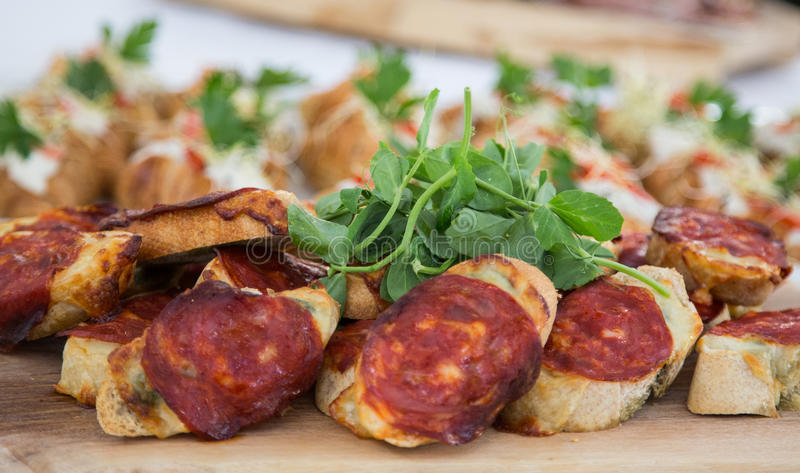 Tapas bread with sausage royalty free stock image