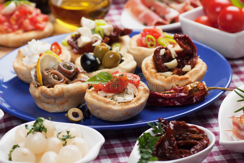 Tapas collection. Antipasto, tapas, various appetizer food traditional in meditarranean countries royalty free stock photos