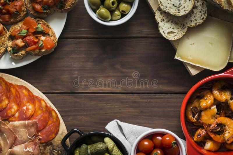 Tapas dishes arranged around clear copy space to form a frame stock photo