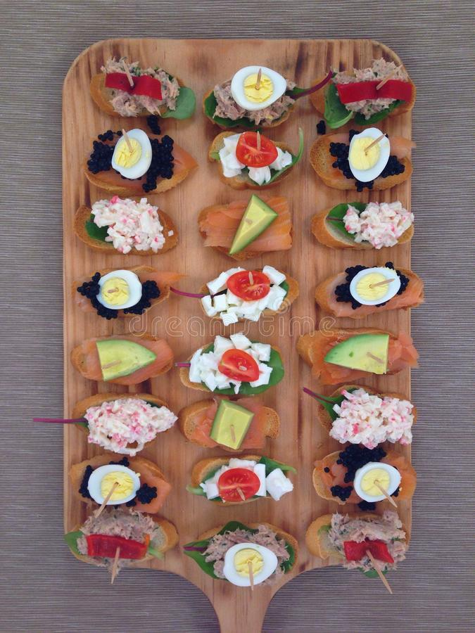 Tapas. Fresh tapas on wooden board royalty free stock images