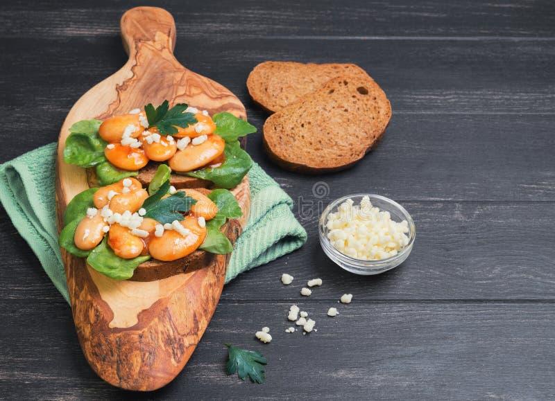 tapas sandwiches with giant white beans stock photos