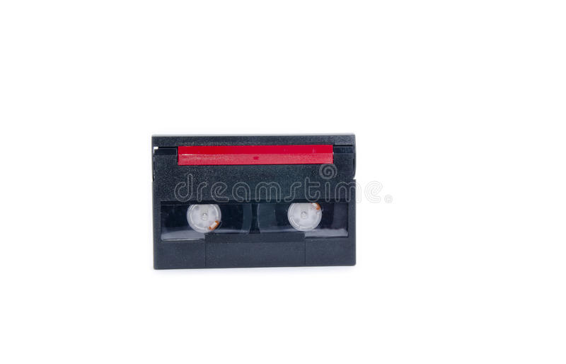 Tape cassette. Old and dusty tape cassette for data backup isolated white background royalty free stock image