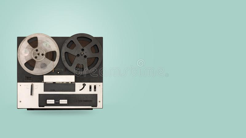 Tape cassette recorder and player with on color background. Retro technology. flat lay, top view hero header. vintage color styles royalty free stock photo