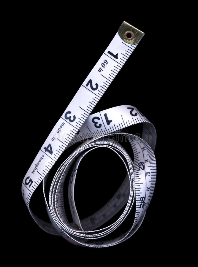 Tape measure. On black background royalty free stock photos