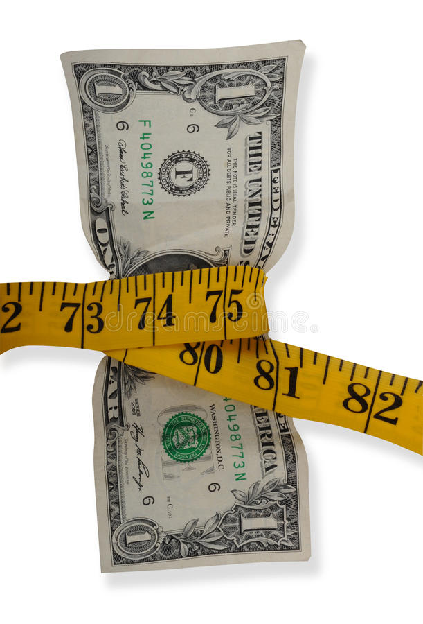 Tape measure around dollar. Tape measure wrapped around center of dollar bill squeezing it, isolated on white background royalty free stock photo