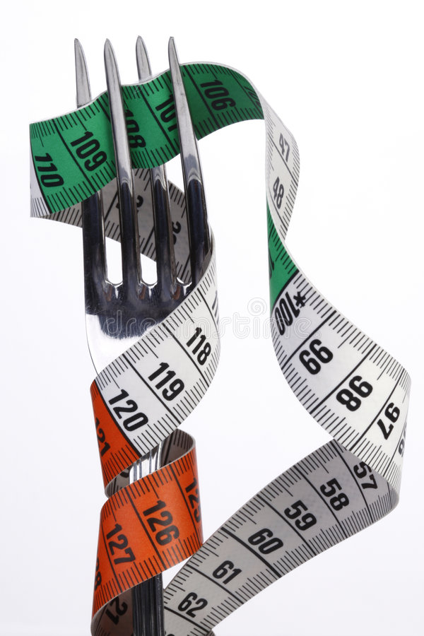 Tape Measure With Fork Royalty Free Stock Photo
