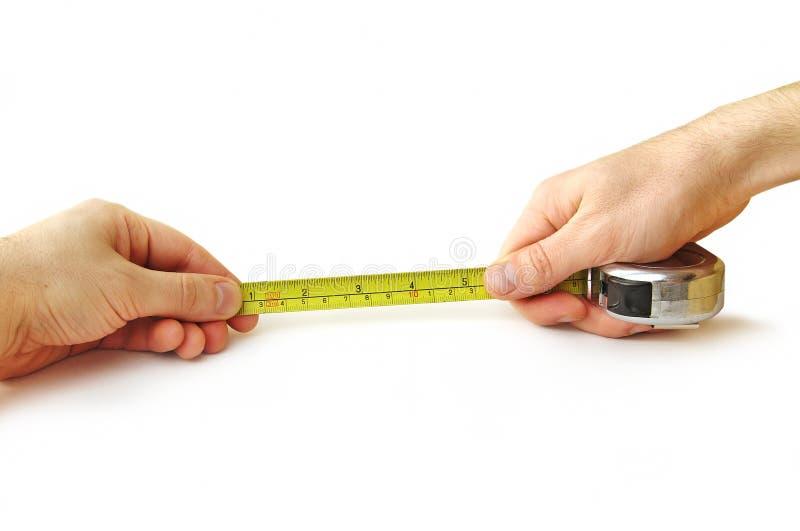 Tape-measure in mani fotografia stock libera da diritti