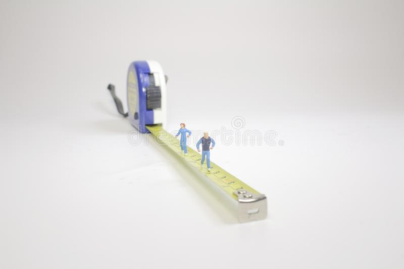 the Tape of measure with running figure stock image