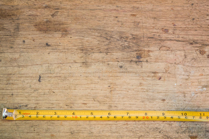 Tape measure,tape measure on the brown wooden background stock images