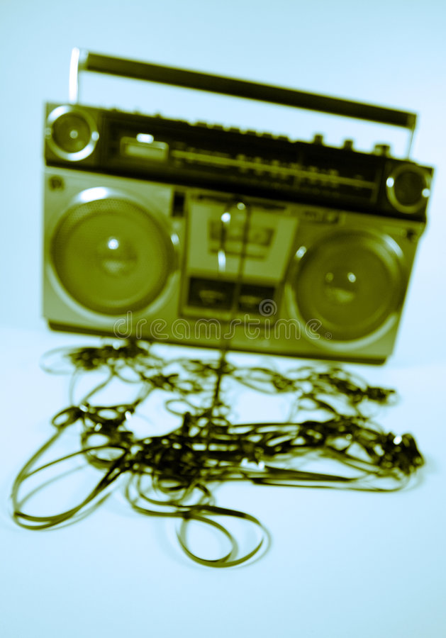 Tape spewing boombox. Cassette tape spewing out of a retro ghettoblaster royalty free stock image