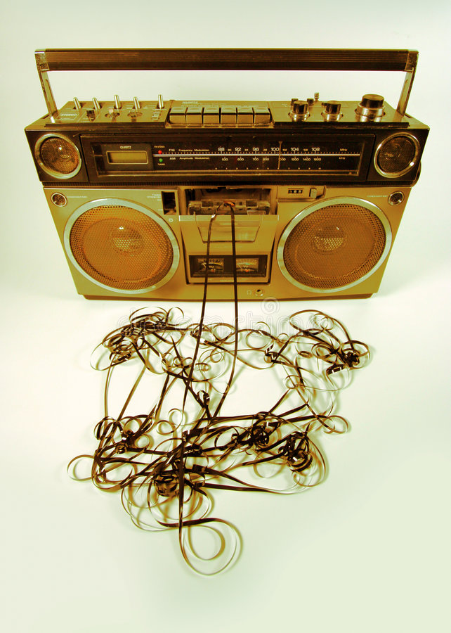 Tape spewing boombox. Cassette tape spewing out of a retro ghettoblaster royalty free stock photography