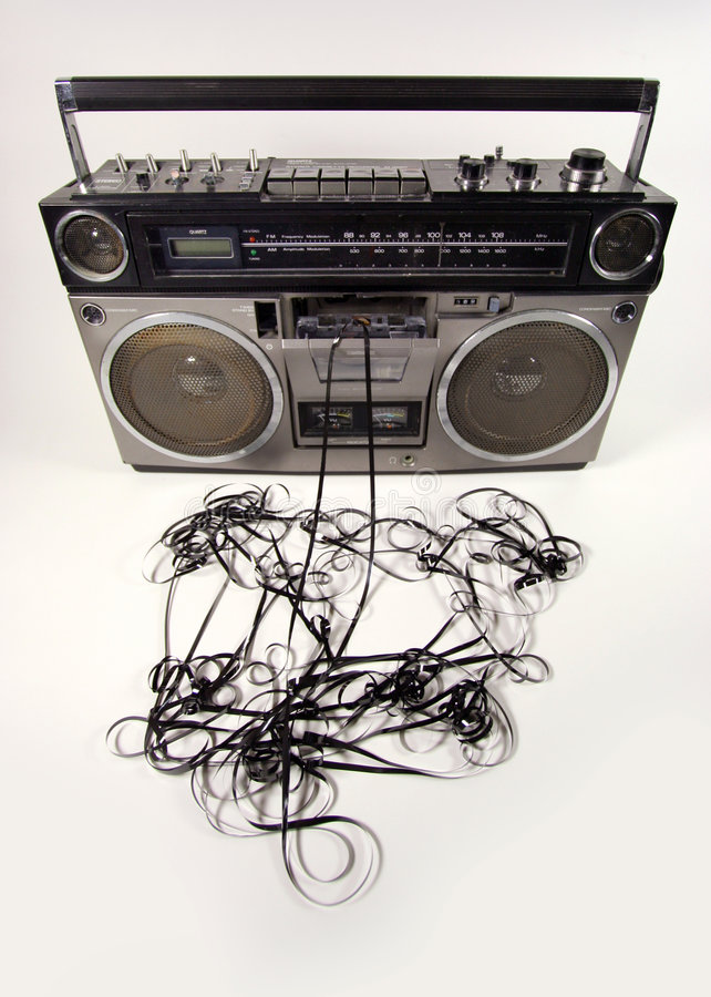 Tape spewing boombox. Cassette tape spewing out of a retro ghettoblaster royalty free stock images