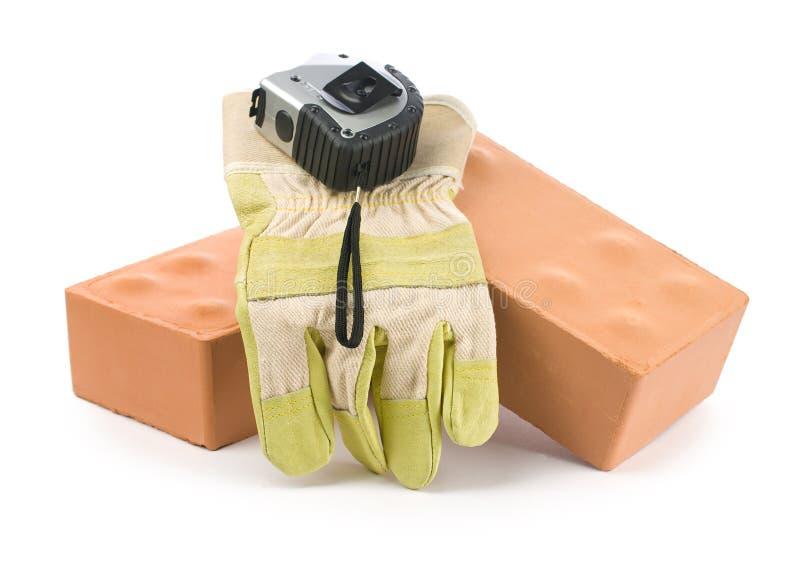tapeline перчатки кирпичей стоковая фотография