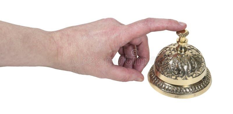 Tapement d'une cloche en laiton de service image libre de droits