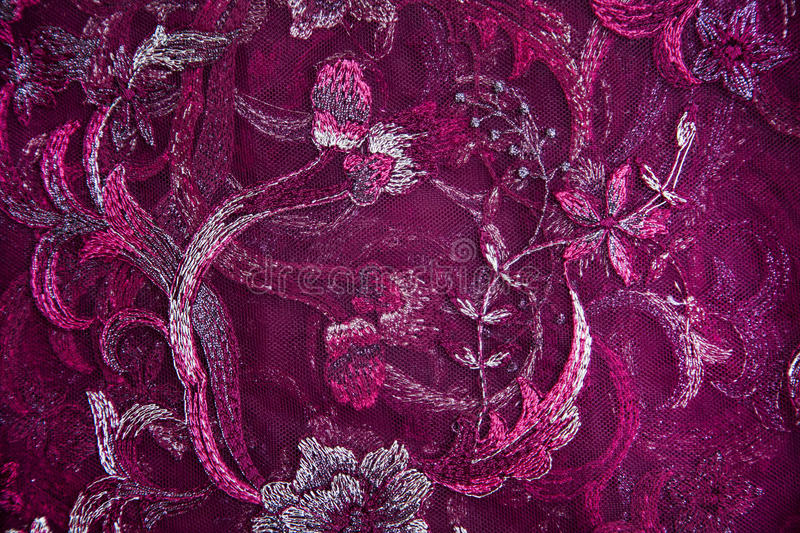 Tapestry fabric with floral pattern in red, pink and purple colors. Tapestry fabric with bright floral pattern in red, pink and purple colors stock photo