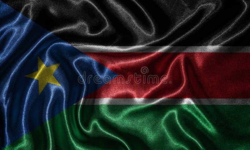 Tapet av den södra Sudan flaggan och den vinkande flaggan vid tyg royaltyfri fotografi