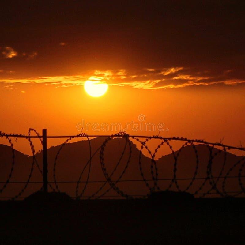 Tapet för bakgrund för soluppgånglandskapbild royaltyfri fotografi