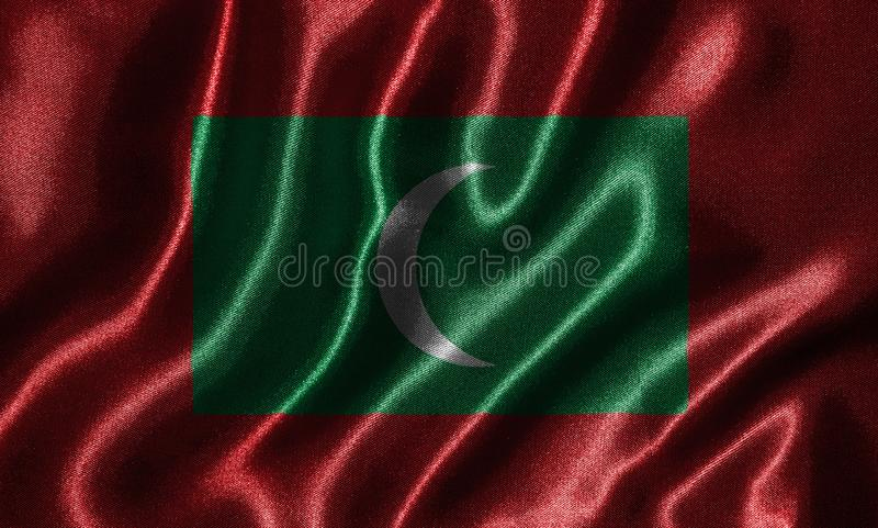 Tapeta Maldives flaga i falowanie zaznaczamy tkaniną obraz stock
