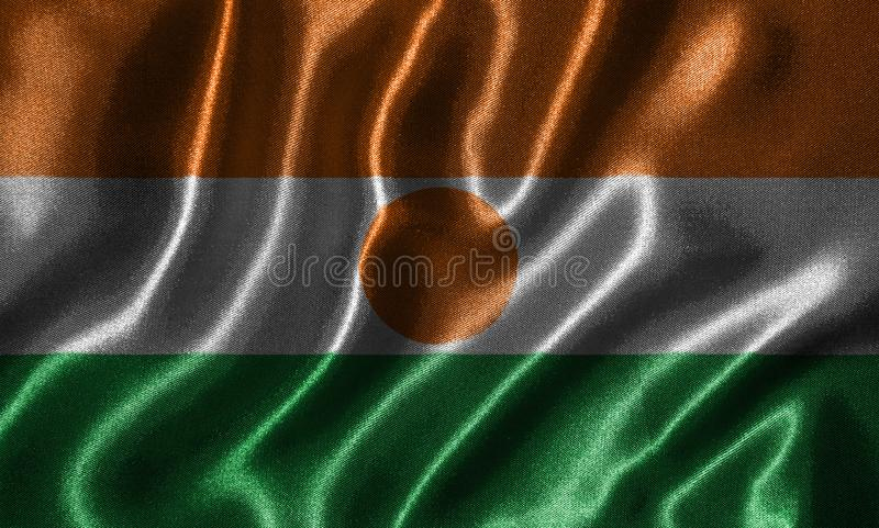 Tapeta Niger flaga i falowanie zaznaczamy tkaniną fotografia stock