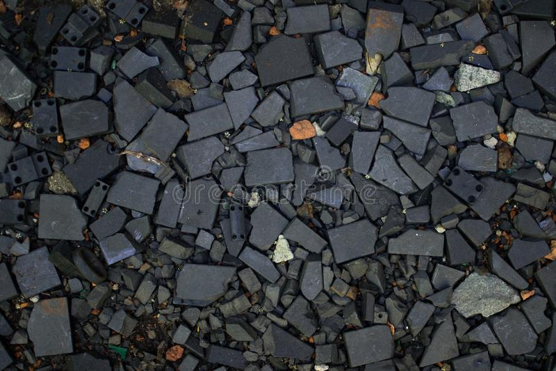 Tapetowy czerń miażdżąca tekstury zbliżenia rockowa powierzchnia zdjęcia stock