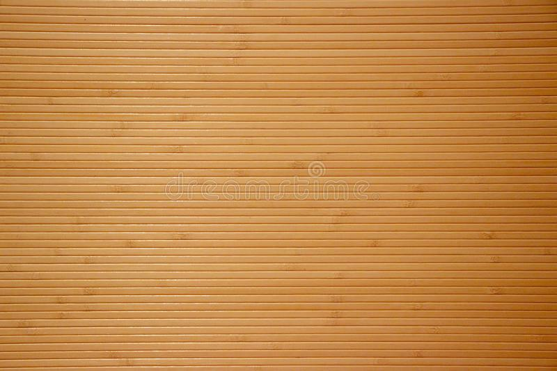 Tapetowy tło pod naturalnym cienkim bambusem zdjęcie stock