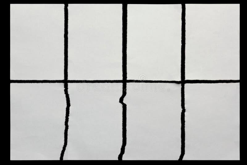 tapezieren Sie zerrissen in acht Stücke auf einem Schwarzen lizenzfreie stockfotos