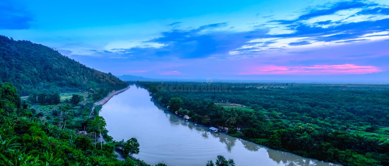 Tapi River is the main river in the south of Thailand. During the evening sunset panorama. stock photo