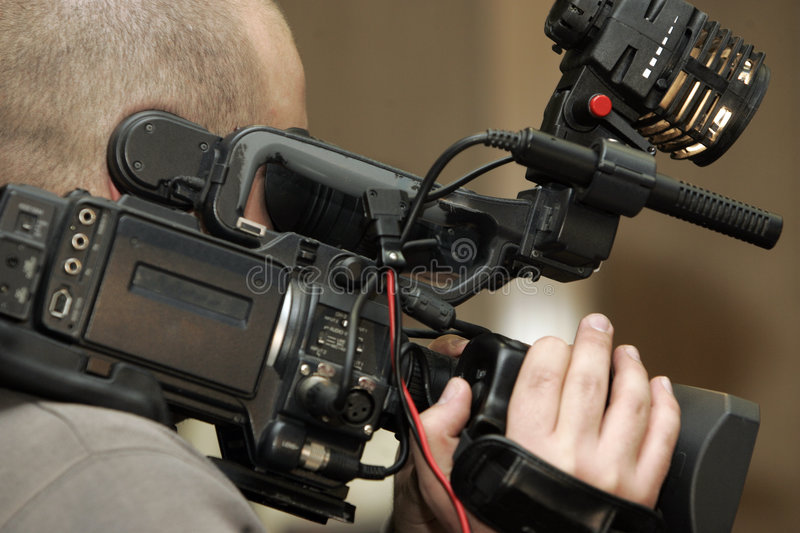 Taping on video camera stock photography