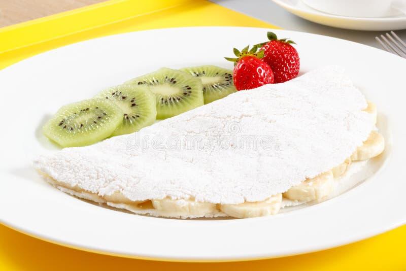 Tapioca with fruits. Traditional Brazilian food stock photography
