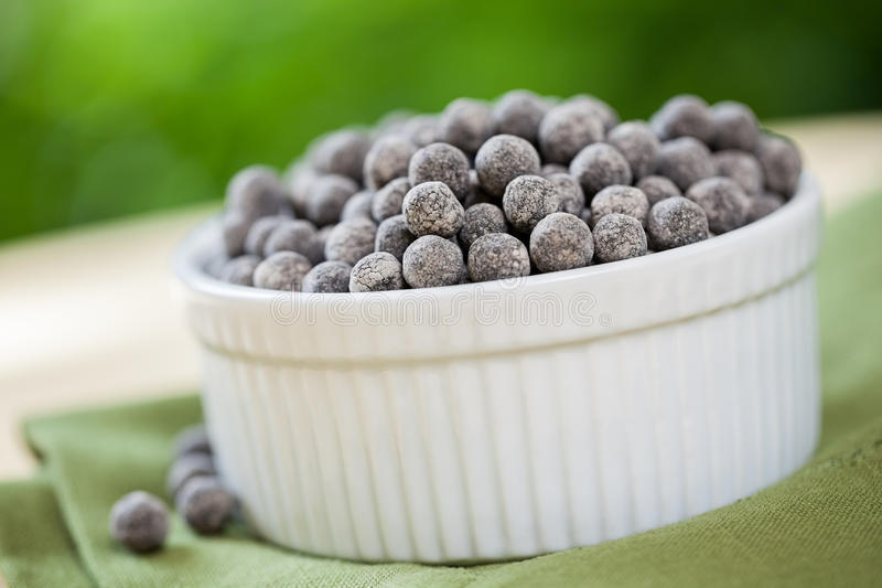 Tapioca Pearls. Bowl of dried tapioca pearls used in making bubble tea stock photos