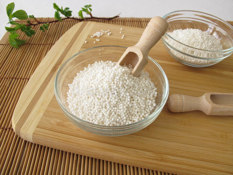 Tapioca Sago. In bowl on cutting board royalty free stock images