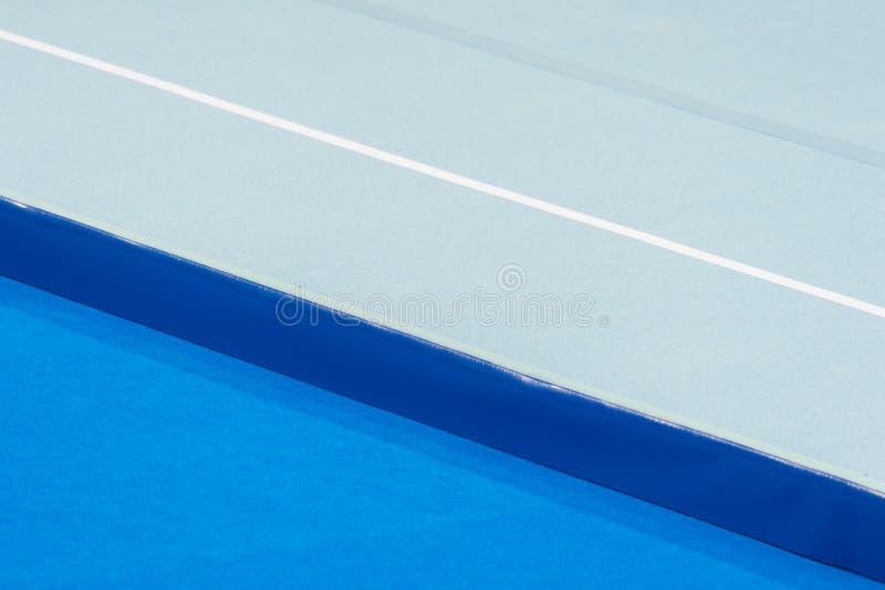 Tapis aérobie de cour de gymnastique photo libre de droits