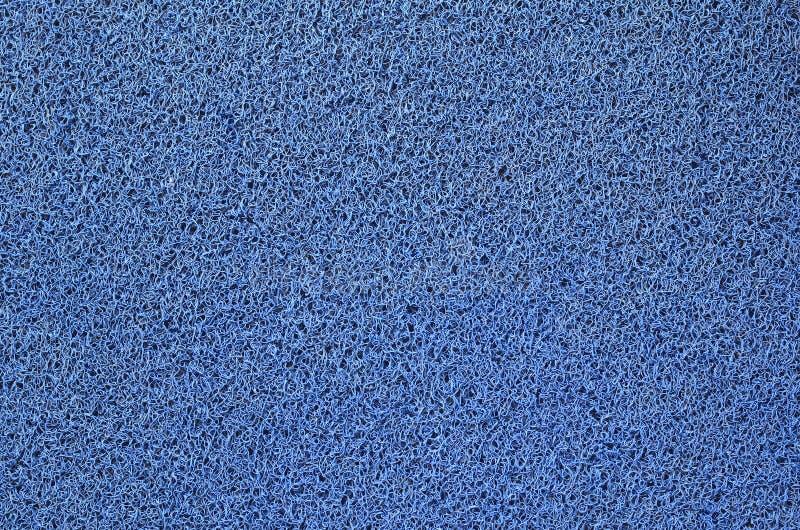 Tapis bleu de pied image stock
