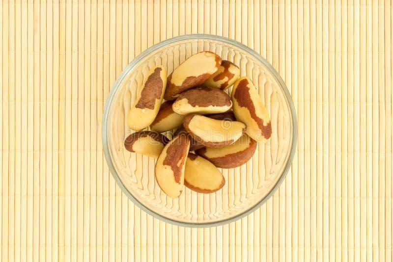 Tapis de noix du brésil et en bambou images libres de droits